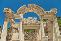Ancient greek temple facade against clear blue sky Stock Photos