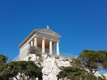 Ancient Greek temple on a mountain against a blue sky in a sunny clear day. French Island Ratonneau near Marseille. Mediterranean stock photography