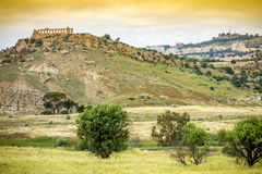Ancient Greek temple ruins and the city of Agrigento in the background, Sicily Royalty Free Stock Photo