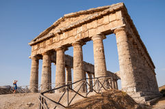 Ancient Greek temple with a tourist taking a picture of it Stock Photos