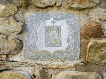 Ancient Greek Virgin Mary picture on the Stone Wall Stock Photos