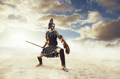 Ancient Greek warrior Achilles in combat. Angry ancient Greek warrior Achilles fighting in the combat with spear in desert landscape stock illustration
