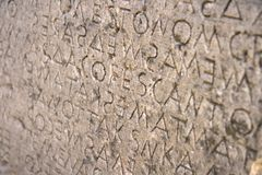 Ancient Greek writing. Ancient Dorian dialet on stone tablet Stock Photo