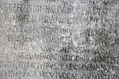 Ancient Greek writing chiseled on stone. Ancient ancient Greek writing chiseled on stone royalty free stock photos