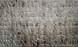 Ancient Greek writing chiseled on stone Royalty Free Stock Photography