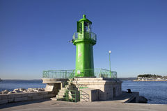 Ancient green lighthouse Stock Images