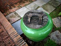 Ancient Green Water Jar with grunge closer Stock Images