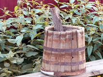 Vintage wooden bucket in the yard of the rural house. Closeup. Ural, Russia.  Stock Photo