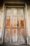 The ancient grungy door. stock photo