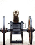 Ancient gun. On a gun carriage shooting kernels Stock Photos