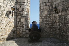Ancient gun in the fortress protecting the city of Hvar. Stock Photography