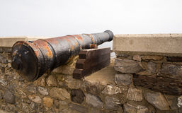Ancient guns on a fortress wall Stock Photos