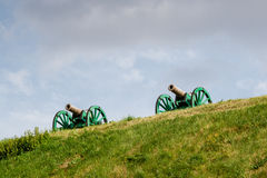 The ancient guns stand on the mountain. Close up Royalty Free Stock Image