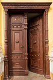 Ancient half-opened wooden door Royalty Free Stock Photo