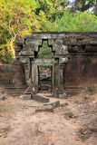 Ancient half-ruined stone gate in a forest Royalty Free Stock Photos