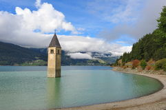 Ancient half-submerged bell tower in Graun im Vinschgau Royalty Free Stock Image