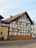 Ancient Half-Timbered House in Germany. Old Half-Timbered House in a Small Village in Germany Royalty Free Stock Photo