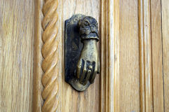 Ancient hand doorknocker from copper Stock Photos