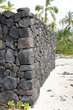 Ancient Hawaiian volcanic stone wall Stock Photo
