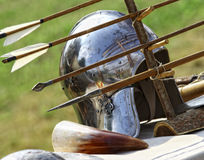Ancient helmet and arrows Stock Image