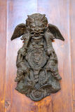 The ancient heraldic symbol with snake and dragon. On the wooden wall stock photo