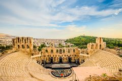 Ancient Herodes Atticus amphitheater with the cityscape on the background stock images