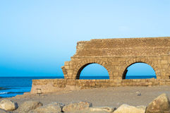 Ancient Herodian aqueduct at the seaside. Part of the remains of the Herodian aqueduct near the ancient city of Caesarea, Israel stock images