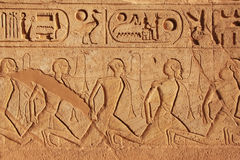 Ancient hieroglyphics on the wall of Great temple of Abu Simbel,. Nubia, Egypt Royalty Free Stock Photos