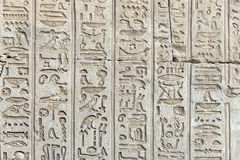 Ancient hieroglyphics on the wall of the temple. Ancient Egyptian hieroglyphs on the wall of the Temple of Hathor Royalty Free Stock Photography