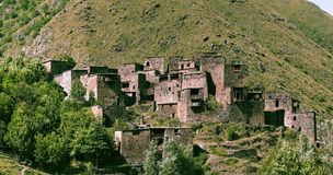 Ancient high-altitude city-fortress in Georgia. Stone houses stuck to the mountainside Royalty Free Stock Image