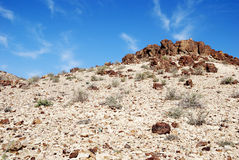 Ancient hill. Ancient rocks under blue sky. Desert Negev, Israel Royalty Free Stock Images