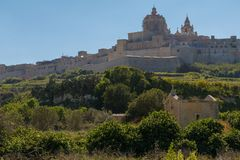 Mdina L-Imdina skyline. Ancient hilltop fortified capital city of Malta, The Silent City, Mdina or L-Imdina, it`s skyline against blue Spring skies with huge Royalty Free Stock Images