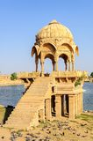Ancient hindu stone temple beside lake. Ancient hindu stone temple beside Gadisar lake, Jaisalmer, Rajasthan, India Royalty Free Stock Photography