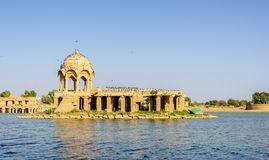 Ancient hindu stone temple in the middle of lake. Ancient hindu stone temple in the middle of Gadisar lake, Jaisalmer, Rajasthan Royalty Free Stock Photo