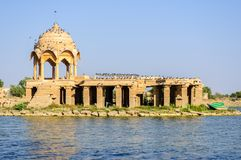 Ancient hindu stone temple in the middle of lake. Ancient hindu stone temple in the middle of Gadisar lake, Jaisalmer, Rajasthan Royalty Free Stock Image