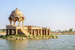 Ancient hindu stone temple in the middle of lake. Ancient hindu stone temple in the middle of Gadisar lake, Jaisalmer, Rajasthan Stock Images