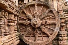 Ancient Hindu Temple at Konark (India). Intricate carvings on a stone wheel in the ancient Surya Hindu Temple at Konark, Orissa, India. 13th Century AD Stock Photo