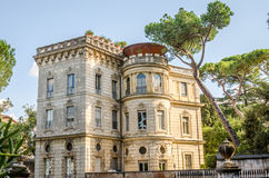 Ancient historical building house palazzo with windows in the trees near the Piazza Garibaldi in Rome, Italy Royalty Free Stock Photography