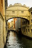 Ancient historical canal brick bridge across small water canal in the waterfront city royalty free stock photos