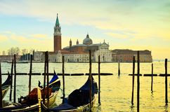 Ancient historical church tower complex with gondola and sea water in the waterfront downtown city center stock photo