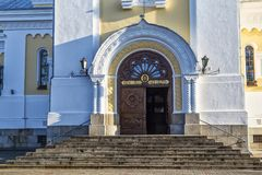 Holy Transfiguration Cathedral.Zhytomyr Zhitomir. Ukraine. Ancient historical Holy Transfiguration Cathedral on the blue sky background. Stairway to the central stock images