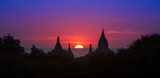 Ancient historical site Bagan in Myanmar at majestic sunset. With beautiful sky and sun disk Royalty Free Stock Photos