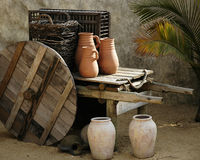 Ancient Home Life. Pottery and wooden ware depicting ancient mid-eastern domestic life Royalty Free Stock Photography