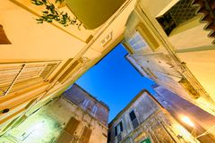 Ancient homes of Tropea, skyward view from the street at sunset Stock Photo