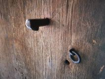 Ancient hook on old wooden door. Medieval iron fastener detail royalty free stock photos