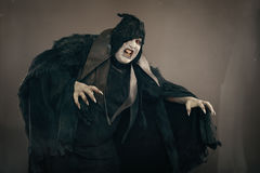 Ancient horror mutant vampire with large scary nails. Medieval f stock image