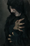 Ancient horror mutant vampire with large scary nails. Medieval f Stock Photography