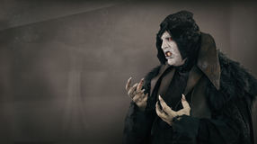 Ancient horror mutant vampire with large scary nails. Text place stock photo