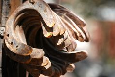 Ancient horseshoes rusted and corroded royalty free stock photography