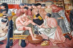 Ancient hospital of Santa Maria della Scala, Siena, Italy. Fresco, Caring for the sick by Domenico di Bartolo, 1440-1441, at the ancient Hospital of Santa Maria stock images